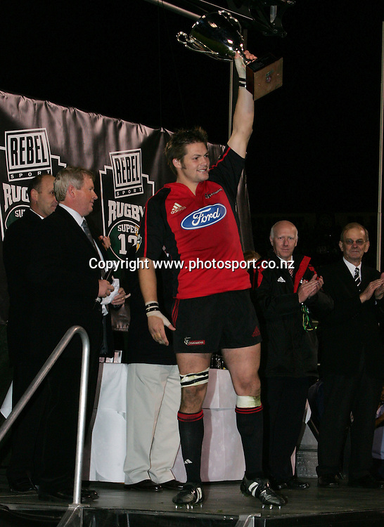 Crusaders captain Ritchie McCaw holds up the Super 12 trophy after winning the Rebel Sport Super 12 final match between the Crusaders and the Waratahs at Jade Stadium, Christchurch, New Zealand on Saturday 28 May, 2005. The Crusaders won the final 35 - 25. Photo: Hannah Johnston/PHOTOSPORT