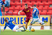 David Turnbull (#28) of Motherwell FC gets to the ball ahead of Chris Kane (#9) and Murray Davidson (#8) of St Johnstone FC during the Ladbrokes Scottish Premiership match between St Johnstone and Motherwell at McDiarmid Stadium, Perth, Scotland on 11 May 2019.