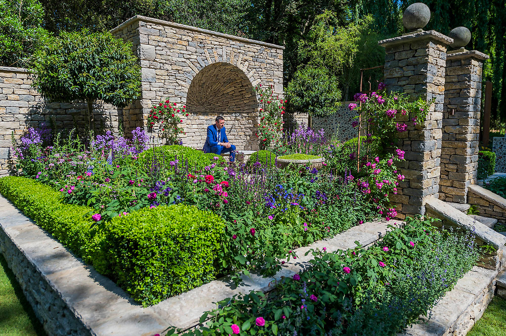 BBC presenter Adam Frost in The Claims Guys: A Very English Garden, Sponsor: The Claims Guys, Designer: Janine Crimmins and Contractor: Andrew Loudon - The RHS Chelsea Flower Show at the Royal Hospital, Chelsea.