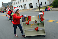 12/1/12 12:37:03 PM - Souderton, PA: .A woman from Indian Valley Library pushes a cart of books on Main Street during the Souderton/Telford Holiday Parade December 1, 2012 in Souderton, Pennsylvania -- (Photo by William Thomas Cain/Cain Images)