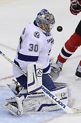 Mar 29; Newark, NJ, USA; Tampa Bay Lightning goalie Dwayne Roloson (30) makes a save during the third period at the Prudential Center. The Devils defeated the Lightning 6-4.