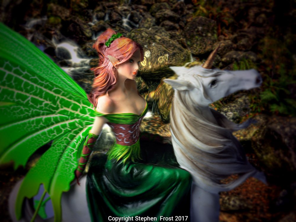 Glimpse of a woodland fairy by the stream. A fantasy image.
