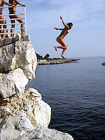 Michelle Rodriguez jumping out of a clif.Hotel Du Cap - 2007 Cannes Film Festival .Cap D'Antibes, France .Wednesday, May 24, 2007.Photo By Celebrityvibe; .To license this image please call (212) 410 5354 ; or.Email: celebrityvibe@gmail.com ;.