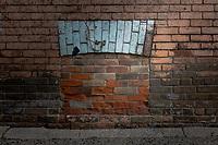 A bricked in basement window.