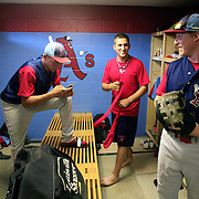 L to R - Corey Cowan, Cory Pallutch and Danny Casey engage in pregame banter in the Clarinda A's clubhouse  photo by David Peterson