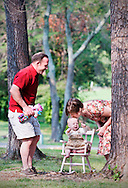 Betsy and Tim Moore with their one-year-old daughter Natalie at Burke Lake Park. (Photo by Alan Lessig)