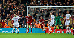 LIVERPOOL, ENGLAND - Tuesday, April 24, 2018: AS Roma's Radja Nainggolan hits the ball towards Liverpool's James Milner who handles it for the penalty during the UEFA Champions League Semi-Final 1st Leg match between Liverpool FC and AS Roma at Anfield. (Pic by David Rawcliffe/Propaganda)