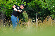 Phil Mickelson plays a shot from the rough during the first round of the 2011 U.S. Open golf tournament at Congressional Country Club in Bethesda, Maryland.