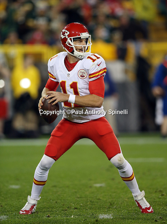 Kansas City Chiefs quarterback Alex Smith (11) drops back to pass in the second quarter during the 2015 NFL week 3 regular season football game against the Green Bay Packers on Monday, Sept. 28, 2015 in Green Bay, Wis. The Packers won the game 38-28. (©Paul Anthony Spinelli)