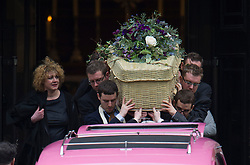 © London News Pictures. 13/02/2014. London, UK. Emily Lloyd-Pack (left) standing next to the coffin as it leaves the church.  The funeral of actor Roger Lloyd-Pack at St Pauls Church also known as 'The Actor's Church'  in Covent Garden, London. Roger Lloyd-Pack was famous for playing roles such as Trigger in Only Fools and Horses and Owen Newitt in the The Vicar of Dibley. Photo credit : Ben Cawthra/LNP