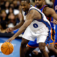 10 March 2007:   Washington Wizards guard Gilbert Arenas (0) fights for control of the ball in the first half against New York Knicks guard Mardy Collins at the Verizon Center in Washington, D.C.  The Knicks defeated the Wizards 90-89.