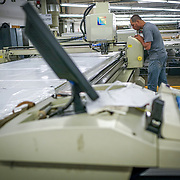 JUNE 28, 2016 --- COROZAL, PUERTO RICO<br /> Luis Correa Negron, Cutting Department  Machine  Gerber Technician readies for a cut of fabric. The company makes pants for the US Army.<br /> (Photo by Angel Valentin/Freelance)