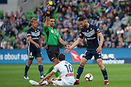Melbourne Victory midfielder Carl Valeri (21) is shown a yellow card at the Hyundai A-League Round 4 soccer match between Melbourne Victory and Central Coast Mariners at AAMI Park in Melbourne.