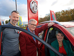 BRIDGEND, WALES - Tuesday, November 5, 2019: Wales manager Ryan Giggs (L) hands over the keys of an MG ZS electric vehicle to the first owners in Wales, Joe and Anne Chester before a press conference at Nathaniel Cars in Bridgend to announce his squad for the final UEFA Euro 2020 Qualifying Group E qualifying matches against Azerbaijan and Hungary. (Pic by David Rawcliffe/Propaganda)