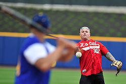 4/26/2014 Allentown, PA Firefighter Chad Long throws the ball to Officer Yamil Castillo. Police Officers and Firefighters from the City of Allentown take to the field at Coca-Cola Park Saturday afternoon for a 90-minute softball game as part of Hero's Night, an IronPigs special event to promote local emergency responders. Express-Times Photo | CHRIS POST