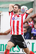 Lincoln City defender Samuel Habergham (3) takes a throw in during the EFL Sky Bet League 2 match between Lincoln City and Exeter City at Sincil Bank, Lincoln, United Kingdom on 30 March 2018. Picture by Mick Atkins.