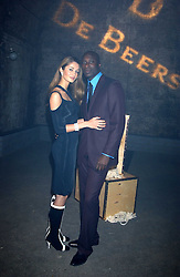 Fashion designer OZWALD BOATENG and his wife GYUNEL at a party for De Beers to celebrate the launch of their Rough diamond •Talisman Collectionê held at Shunt Vaults, London Bridge, London SE1 on 28th November 2005.<br />