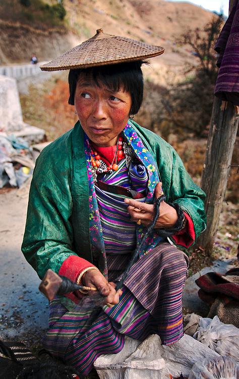 A Bhutanese woman spinning thread in rural Bhutan.