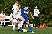 Milton's Caitlyn Dabagian (10) battles for the ball with Rice's Molly McCabe (26) during the girls soccer game between the Milton Yellowjackets and the Rice Green Knights at Rice Memorial High School on Saturday afternoon October 3, 2015 in South Burlington. (BRIAN JENKINS/ for the FREE PRESS)