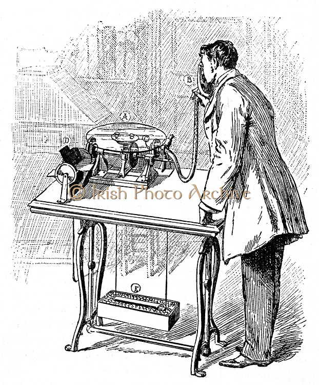 Making recording on Emile Berliner's Gramophone (1887). Speaking into tube produced trace on glass disc (A) coated with lamp-black.  D, electric motor, E its battery. Trace fixed by varnishing, then copied in metal photographically. From 'Cassell's Family Magazine', London, 1888 Engraving