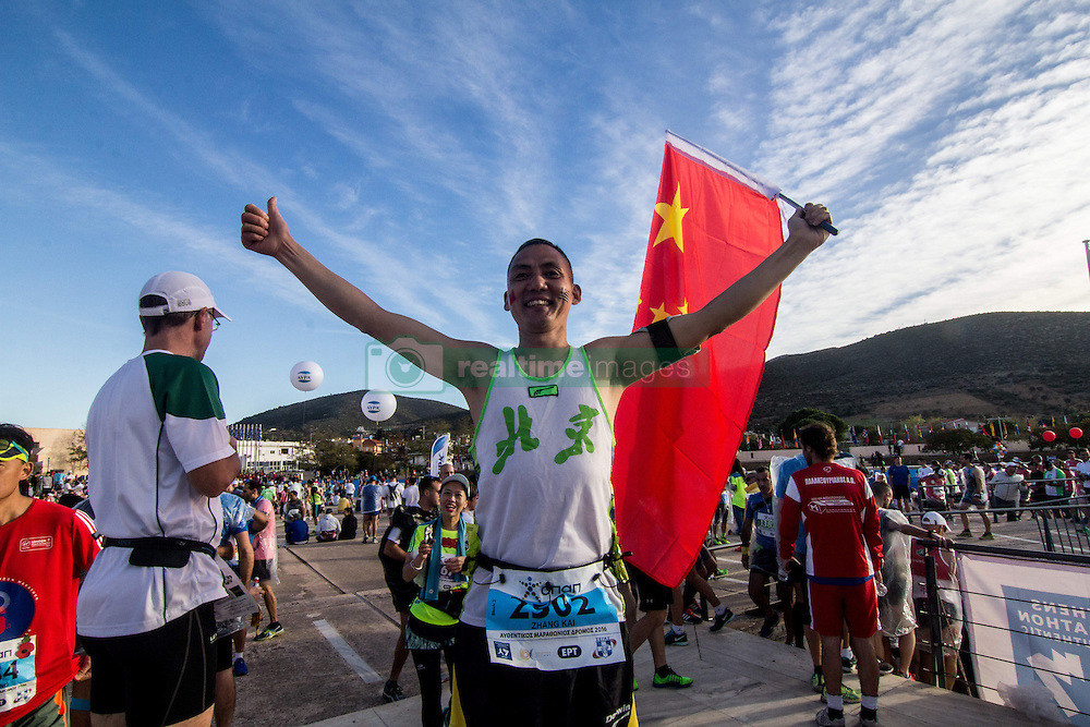 November 13, 2016 - Athens, Greece - A Chinese runner posed before the race. The 34st Athens Authentic Marathon marks the 120th anniversary of the first contemporary Marathon race in 1896. The event is inspired by the ancient hemerodromos that run from Marathonas to Athens to bring the victorious news of the battle against Persians in 480 BC. The race of 1896 was won by the Greek Spiros Louis. The event is dedicated to Grigoris Lambrakis, a doctor, Balkan Athletic Games champion and pacifist. At the Marathon race more than 18000 athletes competed, making a new record of participants. (Credit Image: © Kostas Pikoulas/Pacific Press via ZUMA Wire)