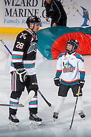KELOWNA, CANADA - NOVEMBER 21: The Pepsi Save On Foods Player of the game looks up at Joe Gatenby #28 of Kelowna Rockets during warm up against the Vancouver Giants on November 21, 2015 at Prospera Place in Kelowna, British Columbia, Canada.  (Photo by Marissa Baecker/Shoot the Breeze)  *** Local Caption *** Pepsi player; Joe Gatenby;