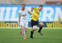 Stephen Kingsley of Swansea City battles for the ball with Chris Maguire of Oxford United - Mandatory byline: Alex James/JMP - 10/01/2016 - FOOTBALL - Kassam Stadium - Oxford, England - Oxford United v Swansea City - FA Cup Third Round
