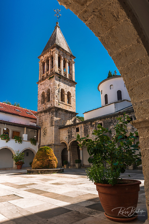 The abbey bell tower and courtyard, Krka Monastery, Krka National Park, Dalmatia, Croatia