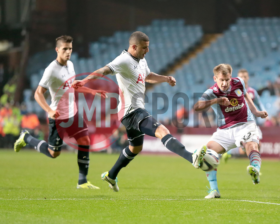 Aston Villa's Marc Albrighton's shot is blocked by Tottenham Hotspur's Kyle Walker  - Photo mandatory by-line: Nigel Pitts-Drake/JMP - Tel: Mobile: 07966 386802 24/09/2013 - SPORT - FOOTBALL -  Villa Park - Birmingham - Aston Villa v Tottenham Hotspur - Round 3 - Capital One Cup