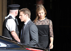 Baroness Thatcher's grandchildren Michael and Amanda  leave the service held at the Chapel of St Mary Undercroft  in the Palace of Westminster in London,  Tuesday 16th April .  Photo by: Stephen Lock / i-Images