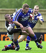 24/05/2002.Sport - Rugby Union - Parker Pen Shield Final..Mark Cueto, carries the Pontypool defender with him, on his run..   [Mandatory Credit, Peter Spurier/ Intersport Images].