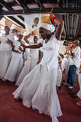 T'Niyah Noel dances the Bamboula while wearing the traditional coal workers basket in remembrance of Queen Coziah and the coal workers who went on strike.  9th Annual Dollar Fo' Dollar Culture and History Tour, a remembrance of the 1892 Coal Workers Strike on St. Thomas.  20 September 2014.  St. Thomas, USVI.  © Aisha-Zakiya Boyd