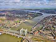 Nederland, Zuid-Holland, Dordrecht, 25-02-2020; Oude Maas, met Spoorbrug Dordrecht (Grote brug) tussen Dordrecht en Zwijndrecht (links). Boven in beeld de rivieren Noord en Beneden Merwede. Naast  de spoorbrug de Drechttunnel (Rijksweg 16).<br /> Oude Maas (old Meuse), with Railway Bridge Dordrecht between Dordrecht and Zwijndrecht (left). View of Drechttunnel (tunnel Dordrecht).<br /> luchtfoto (toeslag op standard tarieven);<br /> aerial photo (additional fee required)<br /> copyright © 2020 foto/photo Siebe Swart