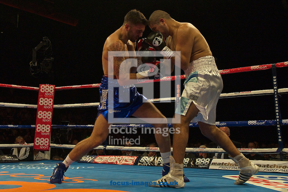 Nathan Cleverly (blue shorts)  v Alejandro Emilio Valori (white shorts) during their WBA Inter-Continental Cruiserweight Championship bout at Echo Arena, Liverpool<br /> Picture by Ian Wadkins/Focus Images Ltd +44 7877 568959<br /> 12/07/2014