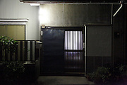 from inside lighted up door of a residential house Japan