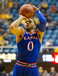 Jan 12, 2016; Morgantown, WV, USA; Kansas Jayhawks guard Frank Mason III (0) shoots a free throw during the first half against the West Virginia Mountaineers at the WVU Coliseum. Mandatory Credit: Ben Queen-USA TODAY Sports