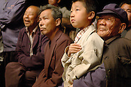 The village has come to attend a repreentation of the opera..Mostly children are fascinated by this form of entertainment. For the new gernerations of Chinese, opera is difficult to undrestand and appreciate. It belongs to another era.