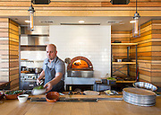 Chef Luke Wetzel prepares food at Oven and Tap on Friday, February 19, 2016, in Bentonville, Arkansas. Beth Hall for the New York Times