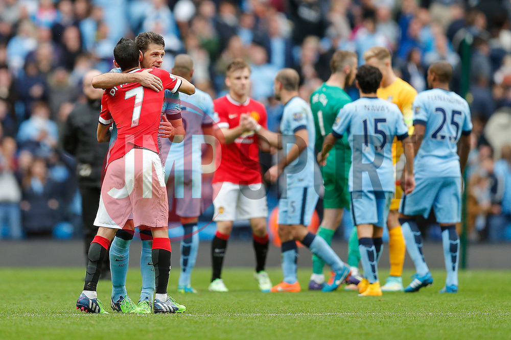 Angel Di Maria of Manchester United is hugged by Martin Demichelis of Manchester City after Manchester City win 1-0 - Photo mandatory by-line: Rogan Thomson/JMP - 07966 386802 - 02/11/2014 - SPORT - FOOTBALL - Manchester, England - Etihad Stadium - Manchester City v Manchester United - Barclays Premier League.