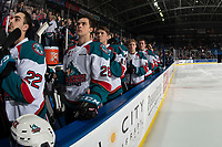 KELOWNA, CANADA - JANUARY 25:  Matt Barberis #22, Leif Mattson #28 an Ethan Ernst #19 of the Kelowna Rockets stand on the bench during the national anthem against the Victoria Royals on January 25, 2019 at Prospera Place in Kelowna, British Columbia, Canada.  (Photo by Marissa Baecker/Shoot the Breeze)