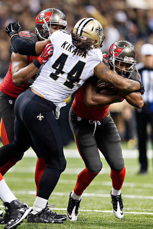 NEW ORLEANS, LA - SEPTEMBER 20:  Charles Sims #34 of the Tampa Bay Buccaneers is tackled by Hau'oli Kikaha #44 of the New Orleans Saints at Mercedes-Benz Superdome on September 20, 2015 in New Orleans Louisiana. The Buccaneers defeated the Saints 26-19.   (Photo by Wesley Hitt/Getty Images) *** Local Caption *** Charles Sims; Hau'oli Kikaha