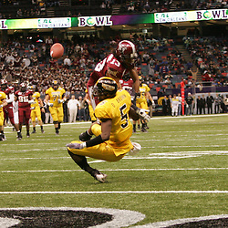 21 December 2008:  Troy defensive back Brandon Lucas (13) knocks the football away from Southern Miss wide receiver DeAndre Brown (5) who lands awkwardly snapping his lower left leg during the first half of a 30-27 overtime victory by the Southern Mississippi Golden Eagles over the Troy Trojans in the  R+L Carriers New Orleans Bowl at the New Orleans Superdome in New Orleans, LA.
