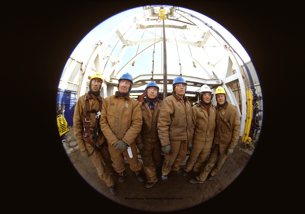 Oil field roughnecks working an onshore rig at Tengiz, Kazakhstan.