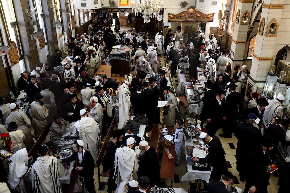 Utra-Orthodox Jewish men celebrate Purim Holiday in the Ultra-Orthodox Jewish neighbourhood of Mea Shearim in Jerusalem, on March 6, 2015. The Jewish holiday of Purim commemorates the salvation of the Jews living with in the borders of the ancient Persian Empire. Purim customs include food gifts, charity, wearing costumes and drinking heavily.