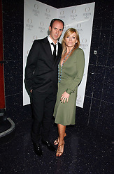 DAVID THOMAS and actress MICHELLE COLLINS at the 40th birthday party and celebration of 20 years as a leading stylist of David Thomas held at Too2Much club, 11 Walkers Court, London W1 on 22nd March 2006.<br />