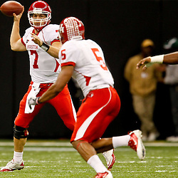 November 10, 2011; New Orleans, LA, USA; Houston Cougars quarterback Case Keenum (7) passes to running back Charles Sims (5) against the Tulane Green Wave during the second quarter at the Mercedes-Benz Superdome.  Mandatory Credit: Derick E. Hingle-US PRESSWIRE