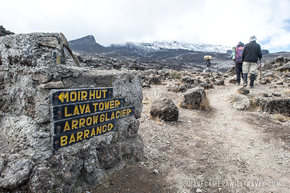 One of the few signs pointing the way amidst the rocky, rugged apline desert on Mt Kilimanjaro Lemosho Route. These shots were taken on the trail between Moir Hut Camp and Lava Tower at approximately 14,500 feet.