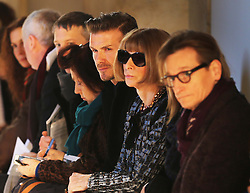 David Beckham sits next to Anna Wintour to watch Victoria Beckham's  show at New York Fashion Week for Autumn/Winter 2013 , Sunday, 10th February 2013. Photo by: Stephen Lock / i-Images