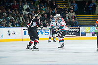 KELOWNA, CANADA - DECEMBER 30: Tyrell Goulbourne #12 of Kelowna Rockets drops the gloves with the Sam Ruopp #2 of Prince George Cougars on December 30, 2014 at Prospera Place in Kelowna, British Columbia, Canada.  (Photo by Marissa Baecker/Shoot the Breeze)  *** Local Caption *** Tyrell Goulbourne; Sam Ruopp;