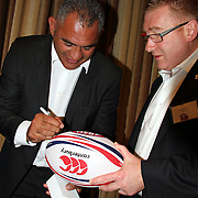 "Eric Rush autographed a ball for a fan after receiving a standing ovation for his humous remarks at the official greeting luncheon.  NZ All Black former players Eric Rush, Frank Bunce, Charles Reichelmann, were honored guests among NZ and USA rugby fans at the pre-game ""Lost Afternoon Rugby Luncheon"" at the Chicago Hyatt Regency Hotel, Chicago, Illinois.  Photo by Barry Markowitz, 10/31/14, 2pm"